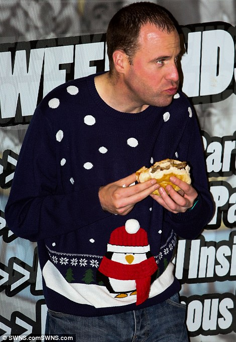 Early night: This reveller in Newcastle enjoys an early burger on a night where authorities struggle to deal with drunk people, many of whom start drinking at lunchtime