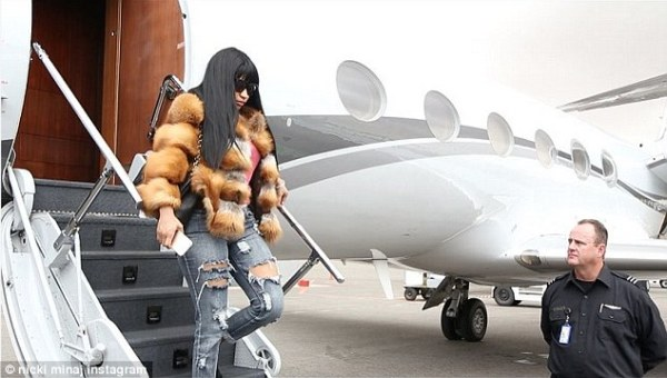 No qualms: The 33-year-old hip hop star arrived in the impoverished African nation on a private jet