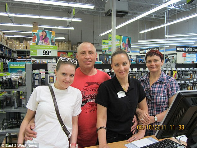 Enjoying America: Tatiana Chernykh (second from right)  with her sister Mariya (left) and their parents in the shop where Tatiana worked