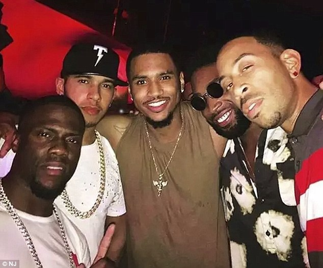 In good company: He joined fellow rappers Ludacris and Tinie Tempah and comedian Kevin Hart to party up a storm after Hamilton retained his World Championship crown