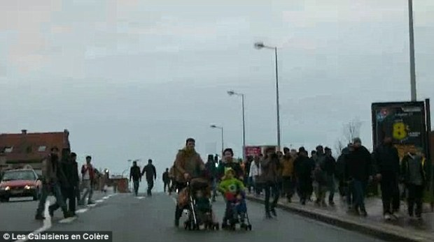 Families: The crowds of people strolling in the streets included parents and their children, with many in the video seen pushing prams