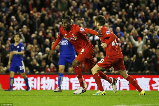Christian Benteke (left) wheels away in celebration after scoring the only goal of the game for Liverpool in their win over Leicester