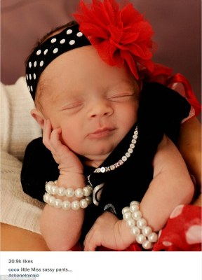 Aww: Coco Austin recently shared this adorable photo of her newborn daughter Chanel Nicole all done up for a holiday photo on Instagram