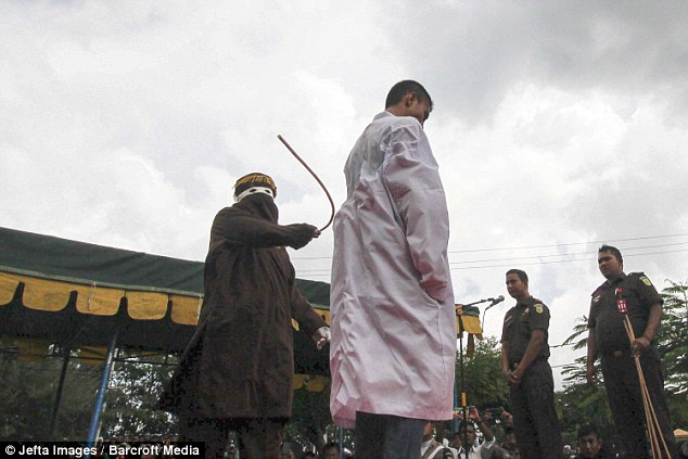 The man was forced to stand as he also received five lashes to his back for breaking strict Sharia law