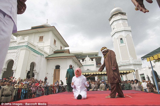 Hundreds of people gathered outside the mosque in Banda Aceh to watch the caning, with some spectators holding up cameras