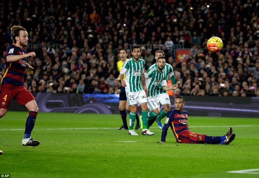 Neymar missed resulting penalty butIvan Rakitic (left) was first to react before the ballrebounded off Heiko Westermann into his own net