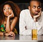 Couple sitting at bar and looking irritated --- Image by © JGI/Jamie Grill/Blend Images/Corbis