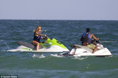 Love race: The two certainly seemed to be enjoying their jetski ride together