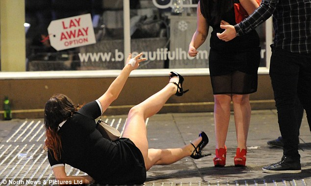 Taking a tumble: A woman holds out a hand to be helped back up after falling over in Newcastle