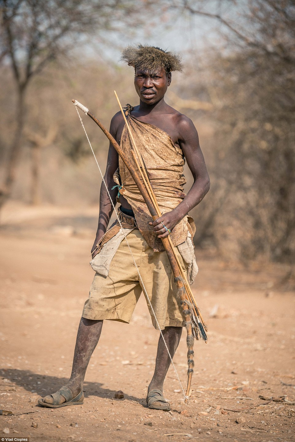 Another group Cioplea met was the weed-smoking Bushman tribe, who taught the photographer their incredible hunting techniques. Pictured is one of their hunters near Lake Eyasi
