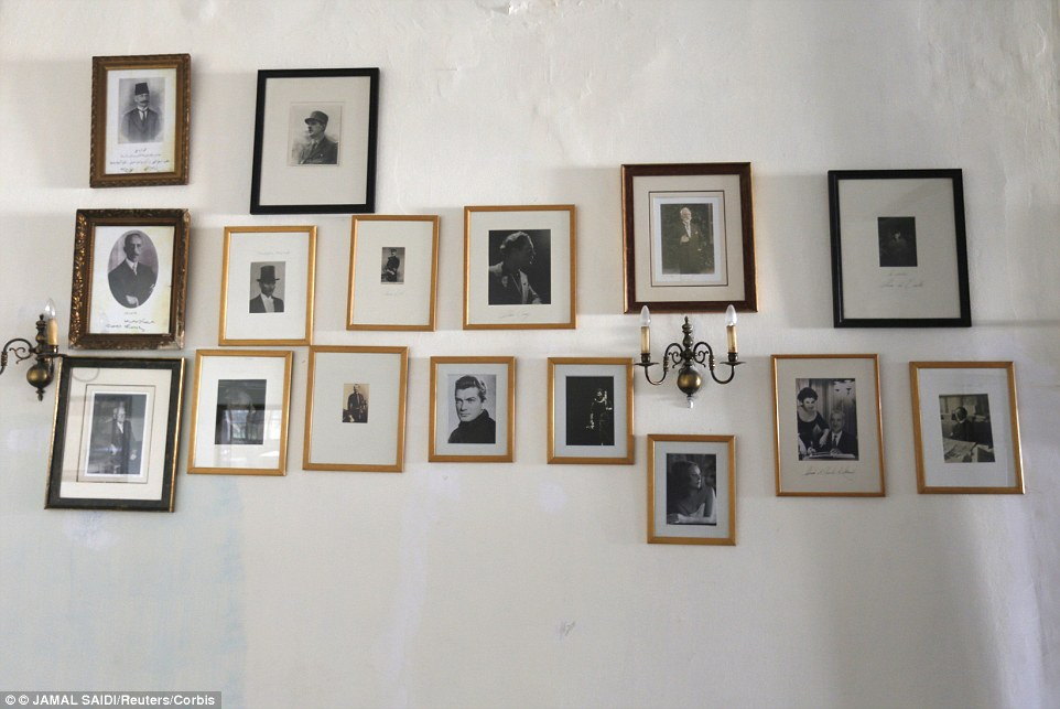 Pictures of famous guests decorate a wall. Jazz singers Nina Simone and Ella Fitzgerald stayed in the famous hotel