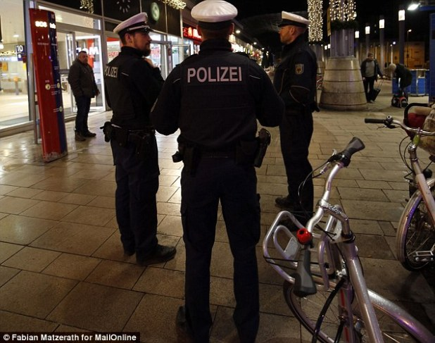 Cologne police stand guard outside the main railway station in Cologne, Germany