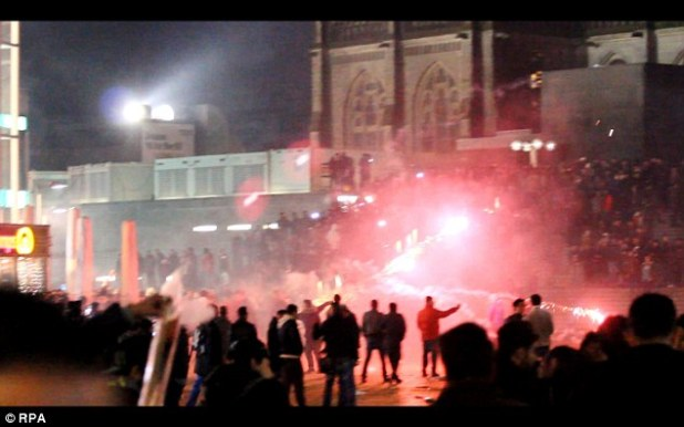 Crowds clash under Germany police, with migrants chucking fireworks in Cologne