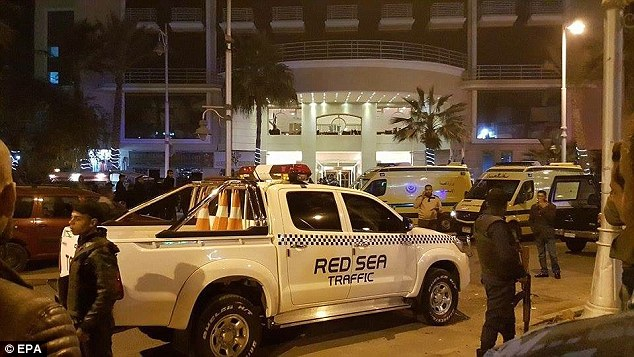 Egyptian security services outside the entrance to Bella Vista Hotel, where the incident happened in the Red Sea resort of Hurghada