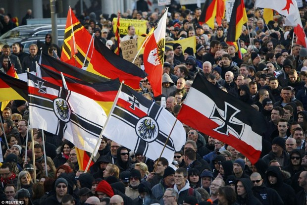 German Chancellor Angela Merkel has backed a toughening of expulsion rules for convicted refugees as protesters took to the streets against a the sexual attacks by gangs of migrants