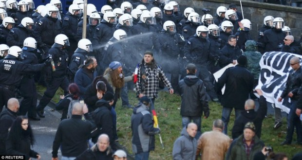 Tension: Security personnel use pepper spray and had water cannon on standby as the Pegida demonstration took place
