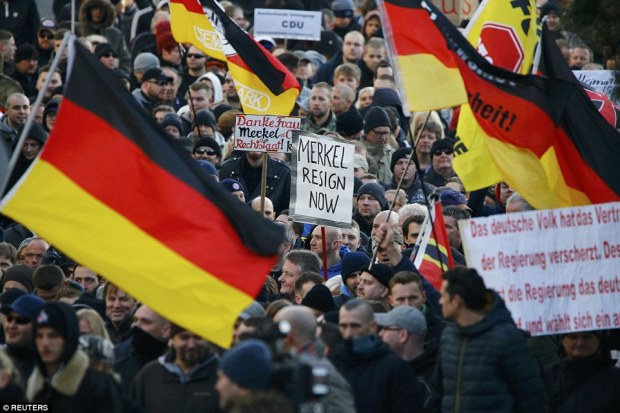 Supporters of anti-immigration right-wing movement Pegida (Patriotic Europeans Against the Islamisation of the West) take part in in demonstration march, in reaction to mass assaults on women on New Year's Eve