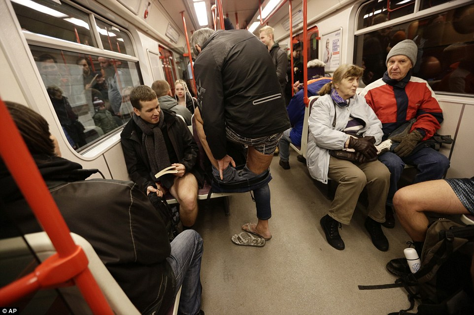 Joining in the fun: This man removes his trousers in order to take part in the Czech Republic's 'No Pants Subway Ride' in Prague