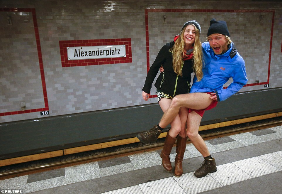 Berlin was one of the 60 cities to participate in the 2016 'No Pants Subway Ride' as these two prepare to ride from Alexanderplatz station
