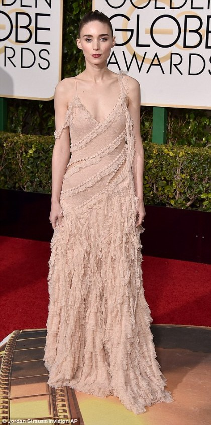 Showing off her unique style: Rooney Mara, who is competing against her Carol co-star Cate, went for an unusual look in a pale pink frock and dramatic make-up