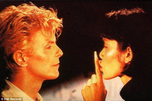 Iconic: China Girl, released in 1983, was filmed in Sydney's Chinatown district, and featured Australian-based, New Zealand model Geeling Ng as David's on-screen love interest.Pictured: David Bowie and Geeling Ng in China Girl music video