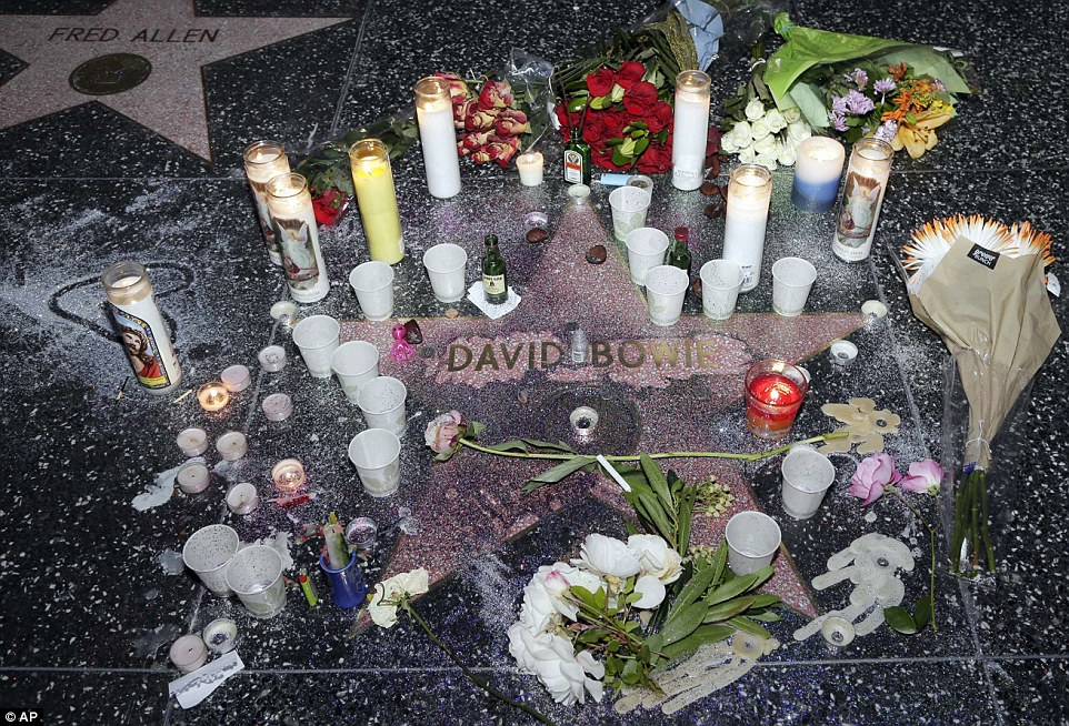 Light: Fans left dozens of candles around the star which is dedicated to Bowie on the Hollywood Walk of Fame in Los Angeles, California