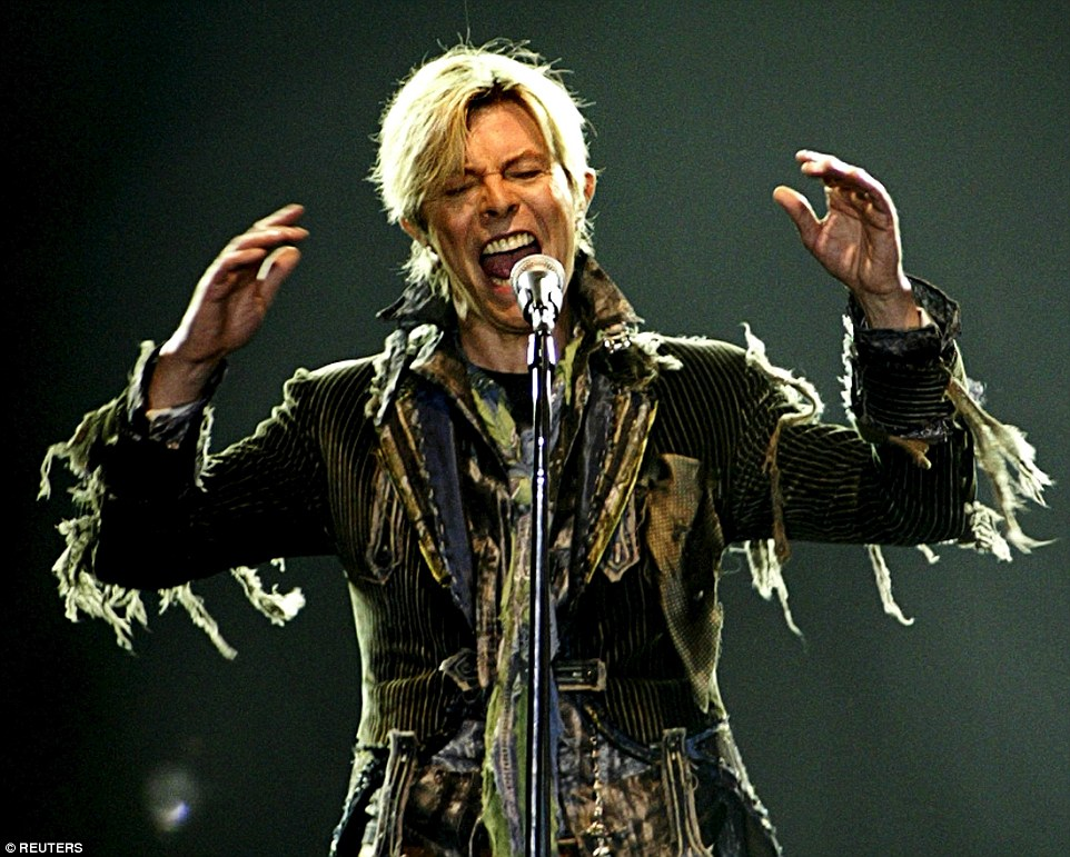 Bowie performs in a concert during his 'A Reality Tour' at the T-Mobile Arena in Prague, Czech Republic, in June 2004