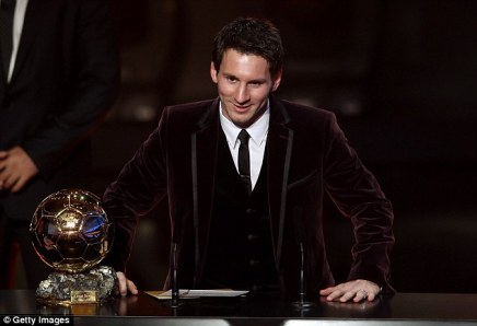 Messi opted for aburgundy velvet suit when he was named as the world's best player for a third time in 2011