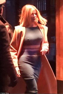 Feeling the chill? The 31-year-old displayed her gorgeous curves (and a little bit more) in a seriously snug green dress