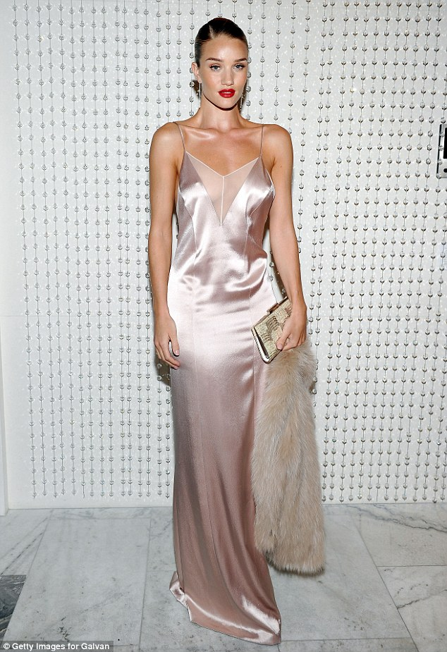 Shimmering: The 28-year-old actress looked good in a shiny pink silk nightie-inspired number