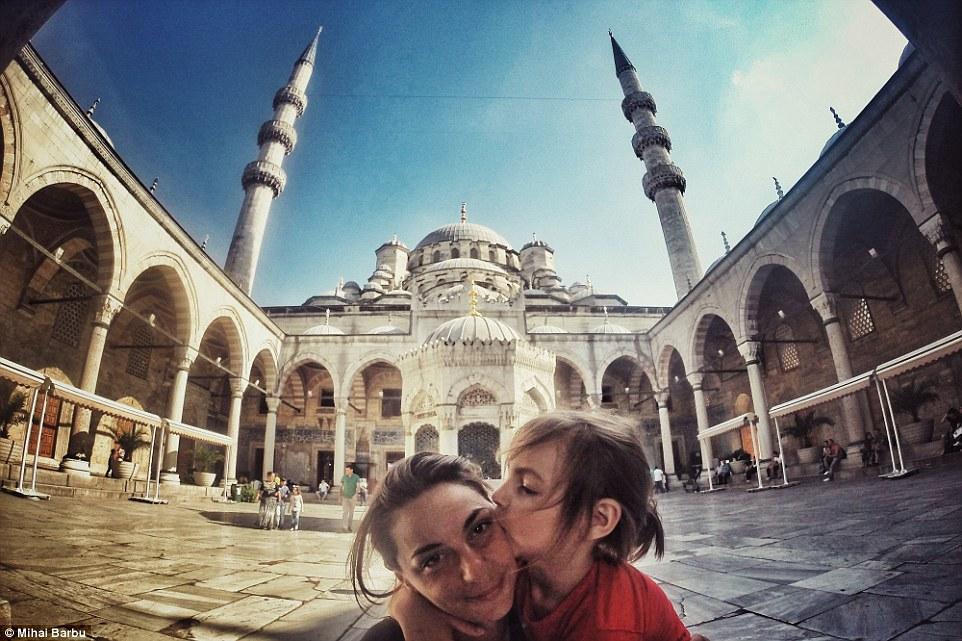 Treasured memories: Vladimir kisses Oana in the Blue Mosque's yard in Istanbul, Turkey