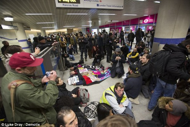 Dozens of campaigners from the London2Calais Convoy group laid down and blocked parts of the St Pancras terminal in an effort to show solidarity with the refugees