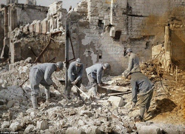 Five French soldiers are clearing the rubble in the ruins of Reims, which was almost 60 per cent destroyed by German artillery and air raids