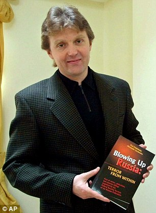 Mr Litvinenko, pictured with his book 'Blowing Up Russia: Terror From Within', frequently wrote critically about President Putin and accused him of being a paedophile
