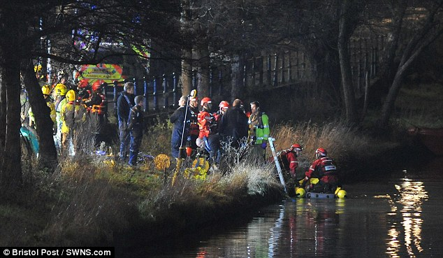 Emergency services pictured searching the canal in Bristol where two people have died in a car crash