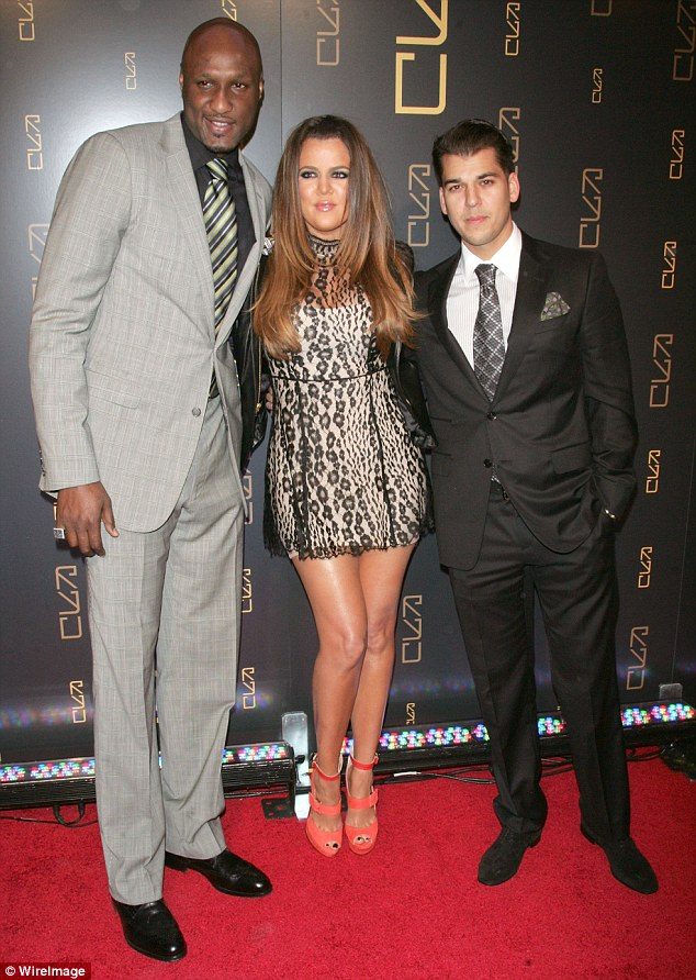 Supportive: Khloe, estranged husband Lamar Odom and Rob in New York in 2012. Khloe let Rob live with her during her marriage and he moved back in with her in 2014 before reportedly moving out late last year