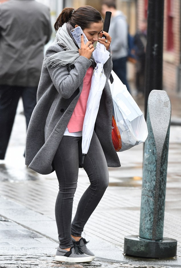 She Just Can't Get Enough! Frankie Bridge cut a relaxed and content figure, flashing a look at her personalised phone cover as she indulged in a bit of retail therapy in Sheffield on Wednesday