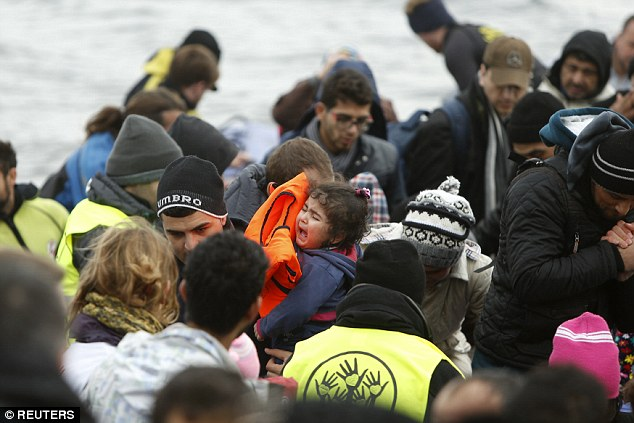 A young girl's cries as she is carried through a throng of people following their arrival on Lesbos on Friday