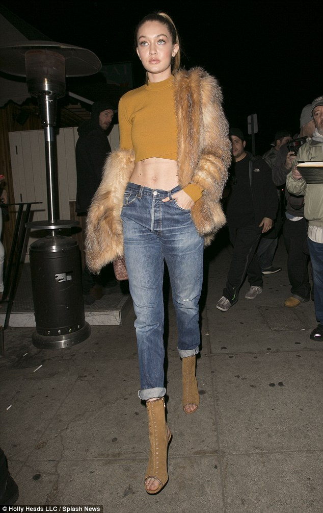 Catwalk ready: Strutting her stuff in camel heels, the star was seemingly flying solo but attracting no less attention