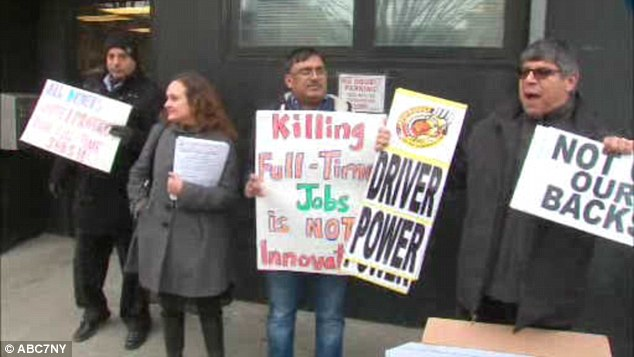 Strike: Drivers were seen protesting outside Uber's head offices in Long Island City this afternoon