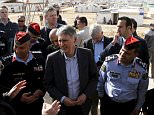 ATTENTION EDITORS - EMBARGOED UNTIL 2300GMTBritain's Foreign Secretary Philip Hammond (C) speaks with former British police officers, who are working with Jordanian police officers in a joint initiative to train and support the Community Police, in front of a mobile community police station, during his visit to Al Zaatari refugee camp in the Jordanian city of Mafraq, near the border with Syria, February 1, 2016. REUTERS/Muhammad HamedTEMPLATE OUT