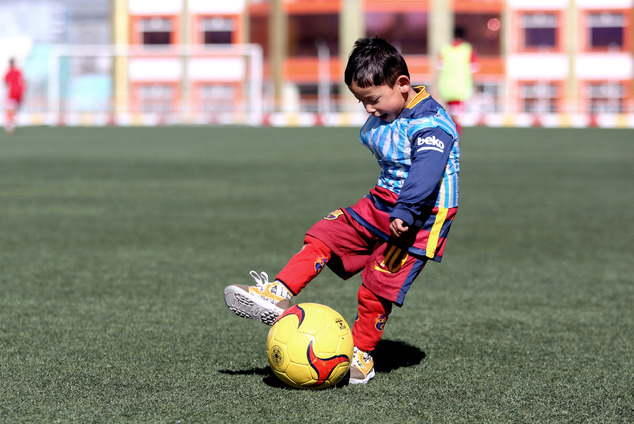Martaza Ahmadi, a five-year-old Afghan Lionel Messi fan plays football, at the Afghan Football Federation Stadium in Kabul, Afghanistan, Tuesday, Feb. 2, 201...