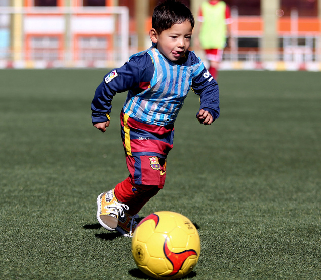 Martaza Ahmadi, a five-year-old Afghan Lionel Messi fan, plays football at the Afghan Football Federation Stadium in Kabul, Afghanistan, Tuesday, Feb. 2, 201...
