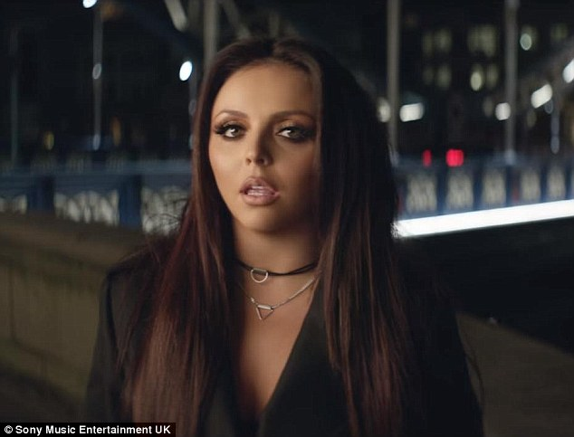 Upping the sex factor: Jesy Nelson injects a touch of sexiness to the video as she's dressed in a wrap-over coat and lace-up thigh-high boots