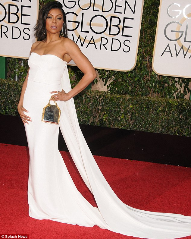 Stunning: The Fox star wowed at the the Golden Globes in January, sporting a strapless white Stella McCartney dress with a cape-like back; pictured January 10 in Los Angeles - she said she loves to shop at Target, but now she is famous finds it harder