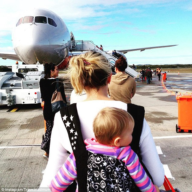 Pictured boarding a plane at Brisbane Airport, Karen said she has no regrets taking her daughter travelling