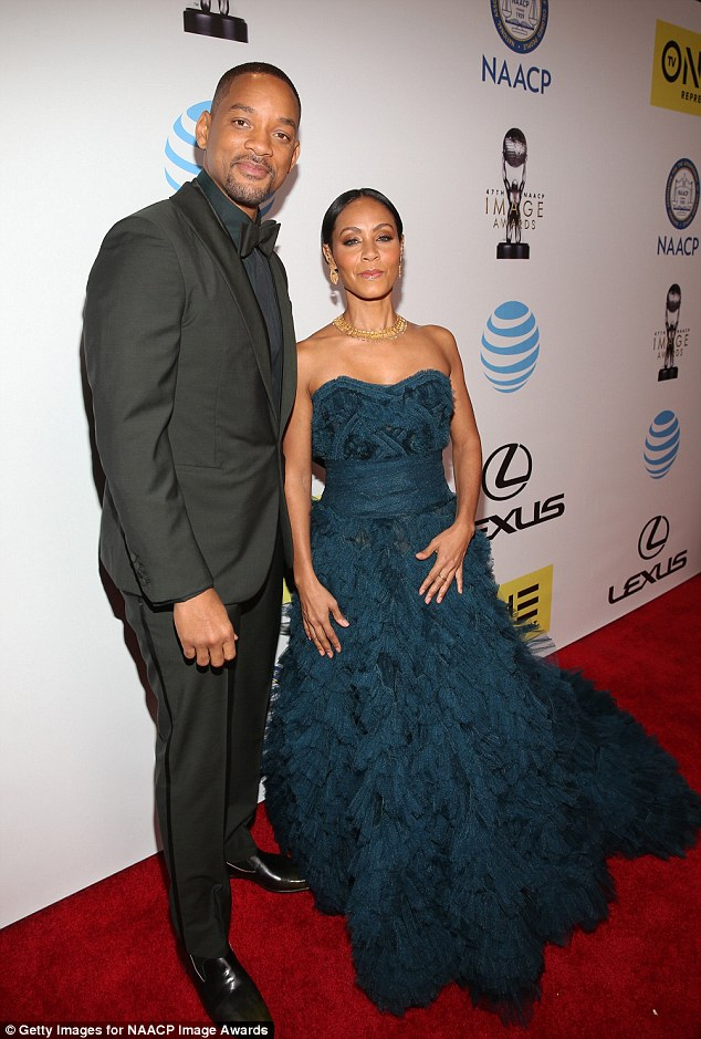 Shine bright: Smith was outshone by his wife's gorgeous and dramatic blue gown