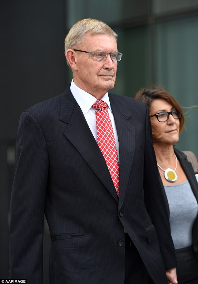 Criminologist Paul Wilson leaves court in Brisbane where he faces four counts of indecent treatment of a girl under the age of 12 in the mid-1970s