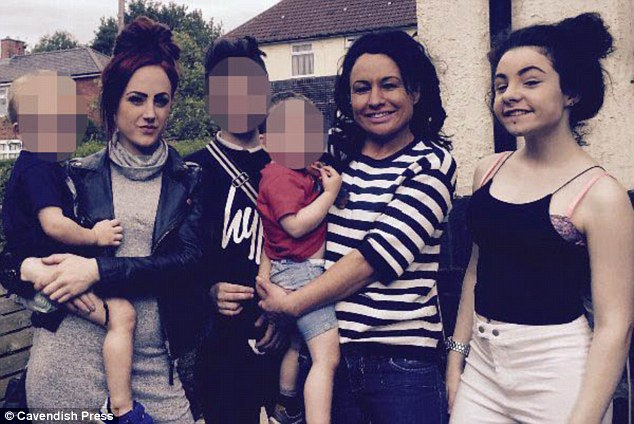 Family: Miss Rayson, 41, is pictured with (from left) her son Rylee, three, daughter Ebony, 20, son Kai, 13, grandson Reun, Miss Rayson herself and daughter Atlanta, 16