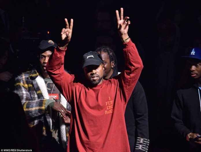 Facing the music: Kanye, who was wearing a long-sleeved tee printed with the words 'I feel like Pablo', started the show with a song calledUltralight Bling